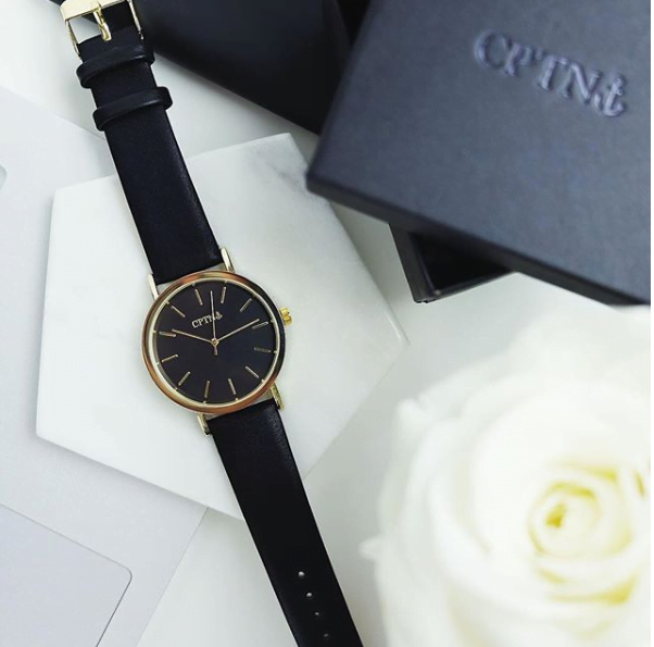 A black CPTN watch on table
