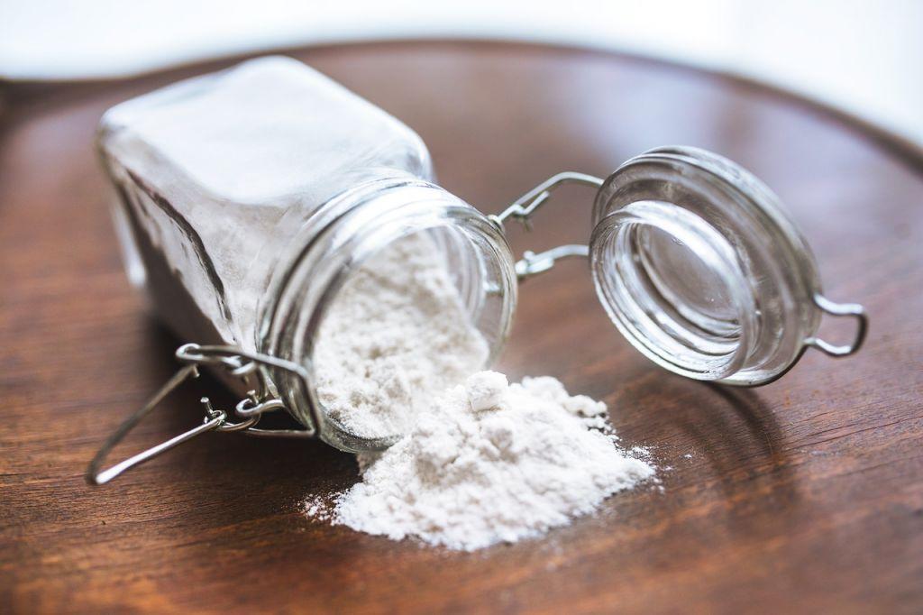 white powder spilling from jar