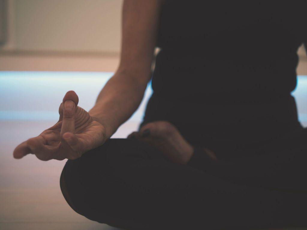 girl sitting and meditating