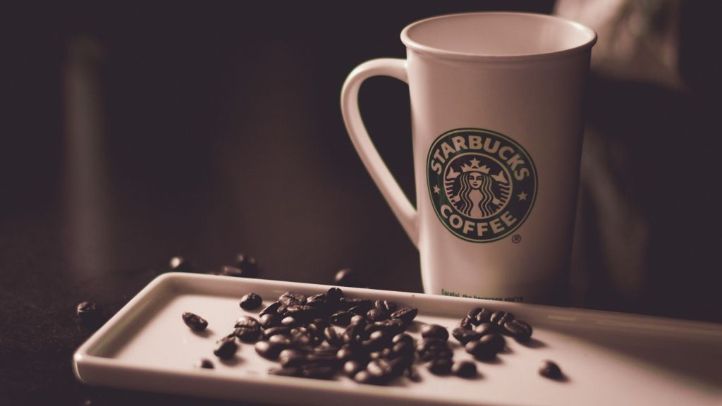 Vegan Starbucks Milk Alternatives - coffee in a cup with coffee beans
