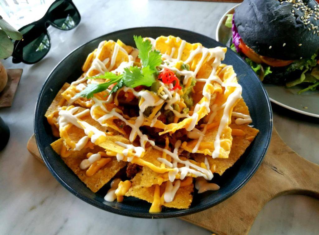 Plate of vegan cheese nachos